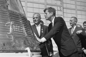 Astronaut John Glenn and President John F. Kennedy inspect the Friendship 7, the Mercury capsule which Glenn rode in orbit. Kennedy presented Distinguished Service medal to Glenn at Cape Canaveral, Fla., Feb. 23, 1962.  In background right is Vice President Lyndon Johnson. (AP Photo/Vincent P. Connolly)